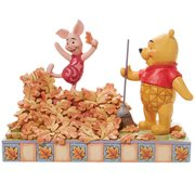 Disney Traditions Winnie the Pooh and Piglet Jumping into Fall by Jim Shore Statue