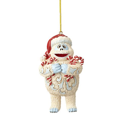 Rudolph the Red-Nosed Reindeer Bumble Holding Candy Canes Ornament by Jim Shore