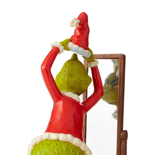 Dr. Seuss The Grinch Dressing in Santa Suit Statue by Jim Shore