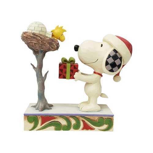 Peanuts Snoopy Giving Woodstock a Gift a Snowy Gift Statue by Jim Shore